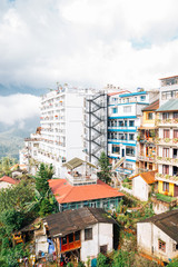 Hotel buildings and mountain with cloud in Sapa, Vietnam