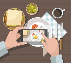 Mobile photography concept. Man taking photos of food on the smartphone