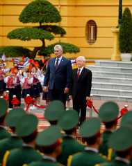Cuba's President Miguel Diaz-Canel and Vietnam's President Nguyen Phu Trong stand at attention during arrival ceremony at the Presidential Palace in Hanoi