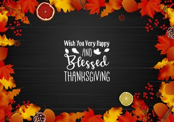 Happy Thanksgiving day with leaves on wooden background
