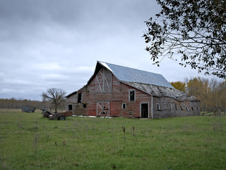Dreary Abandoned Dilapidated Farm Barn with cloudy skies in northern Minnesota