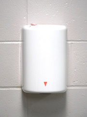 air blower hand dryer on the wall in bathroom