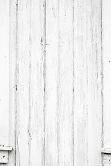 Old weathered wood surface with long vertical boards. Wooden planks on a wall or floor with grain and texture. Light neutral flat faded tones.