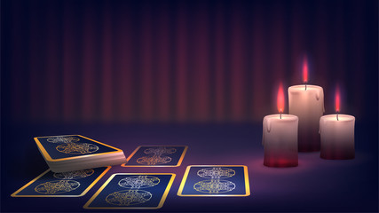 Tarot and candle on the fortune-teller's table, prediction of the future, dark magic