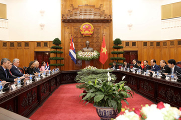 Vietnam's Prime Minister Nguyen Xuan Phuc and Cuba's President Miguel Diaz-Canel meet at the Government Office in Hanoi, Vietnam