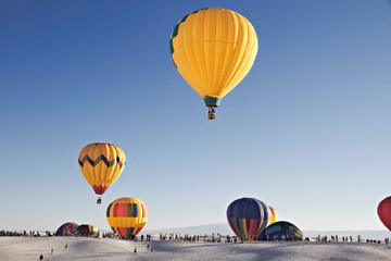 Hot air balloons and white sand dune