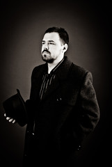 portrait of a man in a black coat on a dark background, Studio photo