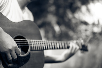 man playing guitar, black&white color tone