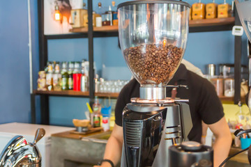 The atmosphere in a cafe with automatic coffee grinder and coffee maker equipment