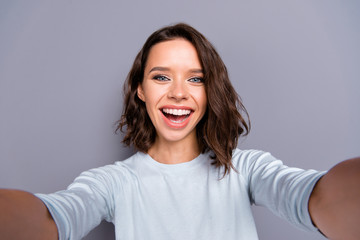 Wall Mural - Attractive lady with beaming toothy smile her curly brunette hai