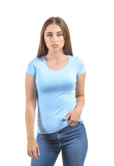 Young woman in stylish t-shirt on white background