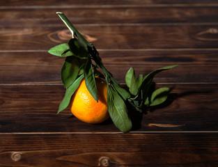 Mandarin on a wooden background, still life