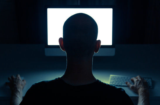 Man grooming on the internet from a desktop computer.