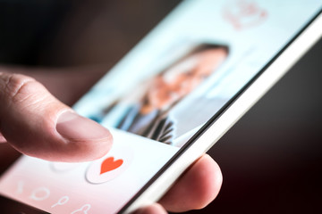 Dating app or site in mobile phone screen. Man swiping and liking profiles on relationship site or application. Single guy using smartphone to find love, partner and girlfriend. Mockup website.