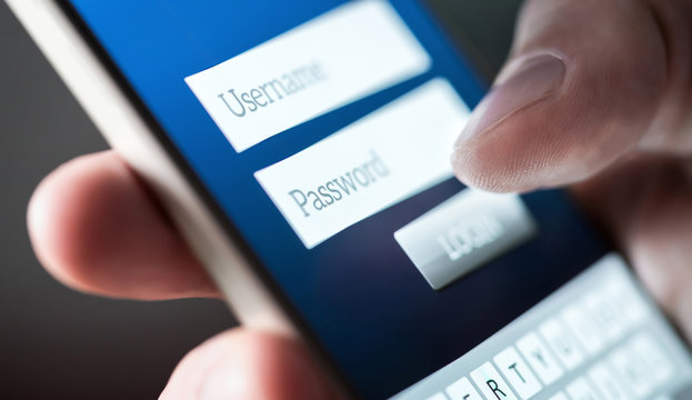 Login with smartphone. Username and password. Registration to website. Personal security. Online bank or personal information. Identity theft, scam or fraud. Macro close up of phone screen.