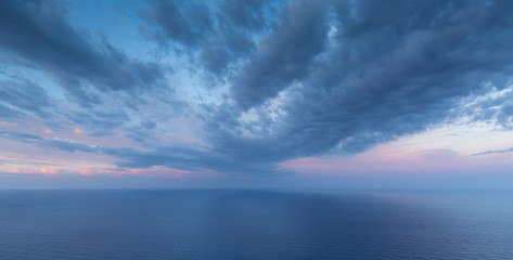 Cloudy dawn at the coast of Corsica, France.
