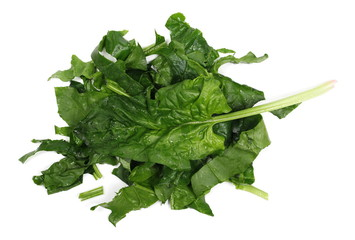 Fresh sliced, cut up spinach leaves isolated on white background, top view