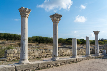 Surviving columns of Basilica in Chersonesos in the Crimea. on blue sky background