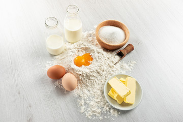Ingredients for dough and pastry on wooden table