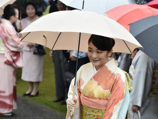 Japan's Princess Mako greets guests during an autumn garden party at Akasaka Palace Imperial garden in Tokyo