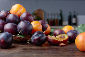 Ripe juicy plums on a kitchen table.