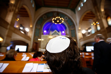 A man wearing a kippah is pictured before a ceremony to mark the 80th anniversary of Kristallnacht, also known as the Night of Broken Glass, at Rykestrasse Synagogue, in Berlin