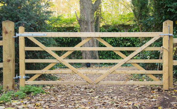 5 Bar wooden gate in a fence leading to a path