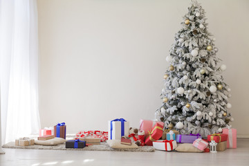Christmas tree with presents, lights new year winter holidays