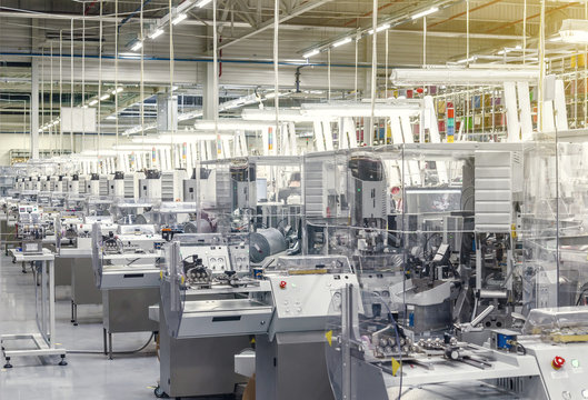 Production machines installed at an industrial enterprise, the production of cables for the automotive industry. Modern equipment.