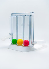 Device for exercising respiration through deep inspiration triple chamber. Medical equipment for respiratory therapy after surgery. Deep Breathing lung exerciser. Breath Measurement. 3 color balls.