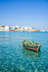 Traditional fishing boat in turquoise waters at Koufonisia, Small Cyclades, Greece