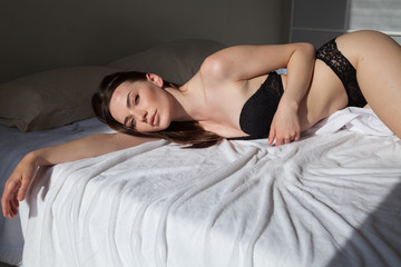 beautiful woman in underwear in the bedroom on the bed night