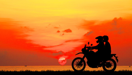 silhouette of love in sunset with classic motorcycle