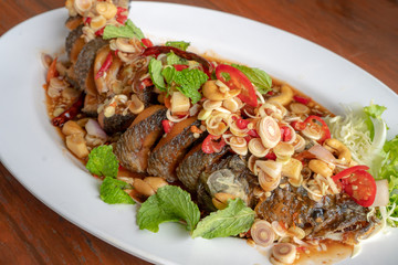 Thai Food,Snakehead fish. on a white plate