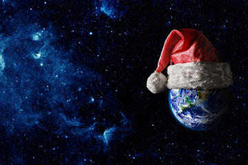 Wall Mural - the earth is wearing a hat for christmas