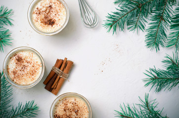Eggnog, Traditional Christmas Drink, Cocktail with Cinnamon and Nutmeg for Winter Holidays
