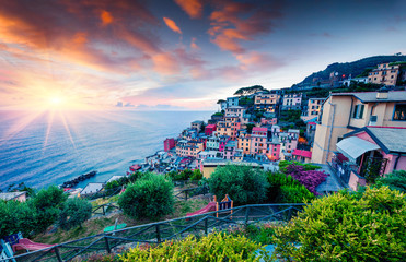First city of the Cique Terre sequence of hill cities - Riomaggiore. Colorful spring sunset in  Liguria, Italy, Europe. Great evening seascape of Mediterranean sea. Traveling concept background. Fototapete