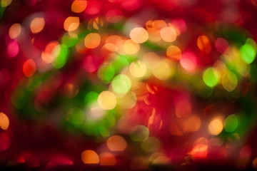 Background. Christmas bokeh. Pattern with traditional colours. Red, green, yellow texture