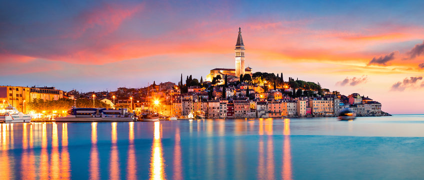 Fantastic spring sunset of Rovinj town, Croatian fishing port on the west coast of the Istrian peninsula. Colorful evening seascape of Adriatic Sea. Traveling concept background.