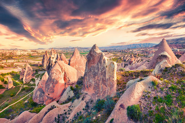 Unreal world of Cappadocia. Impressive sunrise in Red Rose valley in April. Cavusin village located, district of Avanos in Nevsehir Province in the Cappadocia region of Turkey, Asia.  Wall mural