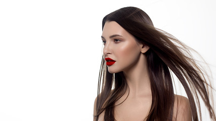 Closeup portrait of a woman with developing straight hair. Sweet tender young girl, brunette. Red lipstick on the lips, transparent transparent skin. Beauty, spa, injections, cosmetology, beautiful