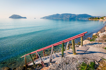 Sunny spring seascape of Ionian sea. Picturesque morning scene in the Port Sostis, Zakynthos (Zante) island, Greece, Europe. Beauty of nature concept background.