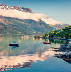 Calm summer morning in Lofthus village in Ullensvang municipality which is located in the Hardanger region of Hordaland county, Norway. Beauty of countryside concept background.