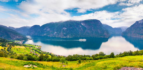 Great summer view of Sognefjorden fjord. Colorful morning scene with Aurlandsvangen village, Norway. Traveling concept background. Artistic style post processed photo.