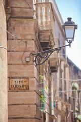 Taranto, Apulia - An old street lamp fixed at a house facade