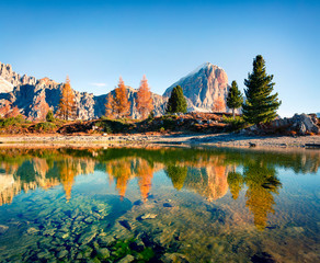 Splendid autumn view of Limides Lake and Lagazuoi mountain. Colorful morning view of Dolomite Alps, Falzarego pass, Cortina d'Ampezzo lacattion, Italy, Europe. Beauty of nature concept background.