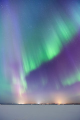 Aurora Borealis, Northern Lights, above frozen lake