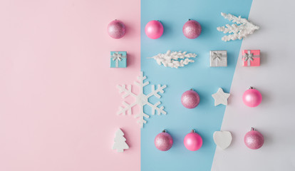 Minimal composition background of pastel pink and blue Christmas decoration. New Year concept.