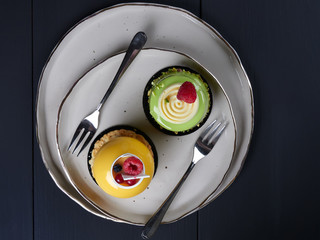 Mango and pistachio cakes, flat lay