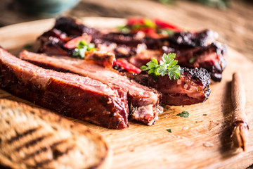Aluminium Prints Grill / Barbecue Tasty barbecue grilled pork ribs with chili pepers and parsley herbs.